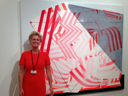 Gallerist Carrie Secrist shows off her Vernissage look, coordinated with a new painting by Andrew Holmquist (Booth #222)