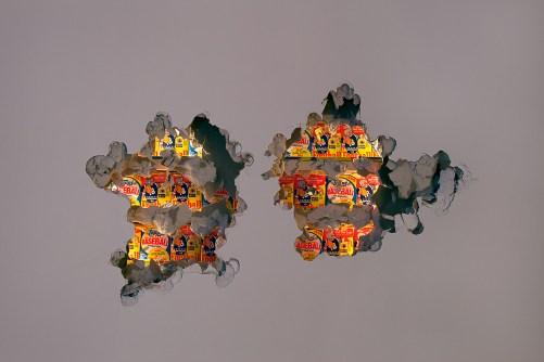 "Bryan Zanisnik. ""Alternative Colors and BHT,"" 2014, site specific installation, baseball, football cards, wall material"