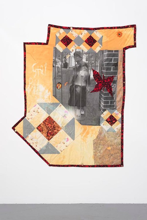 """Erin Jane Nelson. """"Monk Behind Bars,"""" 2015 Inkjet on cotton, cotton, embroidered patches, wool batting, silk ribbon, garden lining fabric, grommets"""