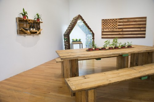 "Emmanuel Pratt in collaboration with Sweet Water Foundation. ""Ecology of Absence?"" Furniture, shelving and American flag made from reclaimed wooden pallets. /Photo: Rob Karlic."