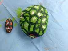 Painted rock creature and turtle