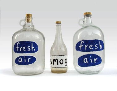"Fresh Air 1 puffy paint and enamel paint on found glass bottle 12"" x 5"" x 5"" 2017. Smog puffy paint & enamel paint on found glass bottle 11"" x 3"" x 3"" 2017. Don Procella. Everything Must Go. Noysky Projects. Photo Courtesy of Noysky Projects."
