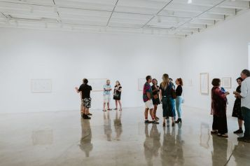 Guests viewing selected drawings in East Gallery at CGU Art. Photo credit: Sargeant Creative