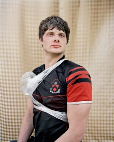 Zak (Second Row, University Team Captain), Princeton, NJ. 2010, Amy Elkins, Photographs of Contemporary Masculinity at Orange Coast College, Frank M. Doyle Arts Pavilion. Photo courtesy of the gallery.