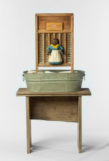 Betye Saar: Keeping it Clean. Craft and Folk Art Museum. Supreme Quality, 1998 Mixed media on vintage washboard, metal washtub, wood stand Courtesy of the artist and Roberts & Tilton, Los Angeles, CA Photo: Tim Lanterman, Scottsdale Museum of Contemporary Art.