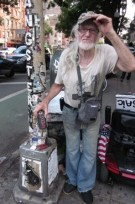 Jim Power, aka The Mosaic Man, at work on 1st Avenue, NYC