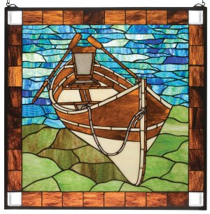 """Beached Canoe Guideboat 