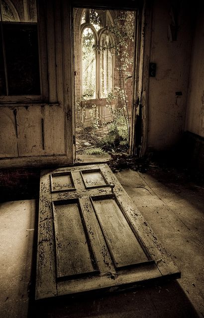 Fallen Door in an Abandoned Home