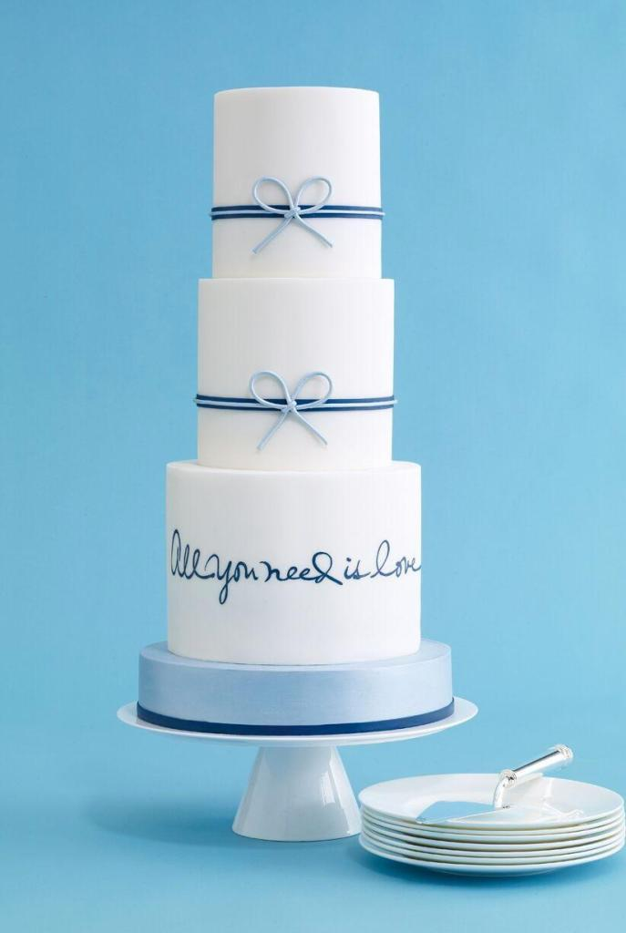 All You Need Is Love Blue Ribbon Wedding Cake photo by Antonis Achilleos
