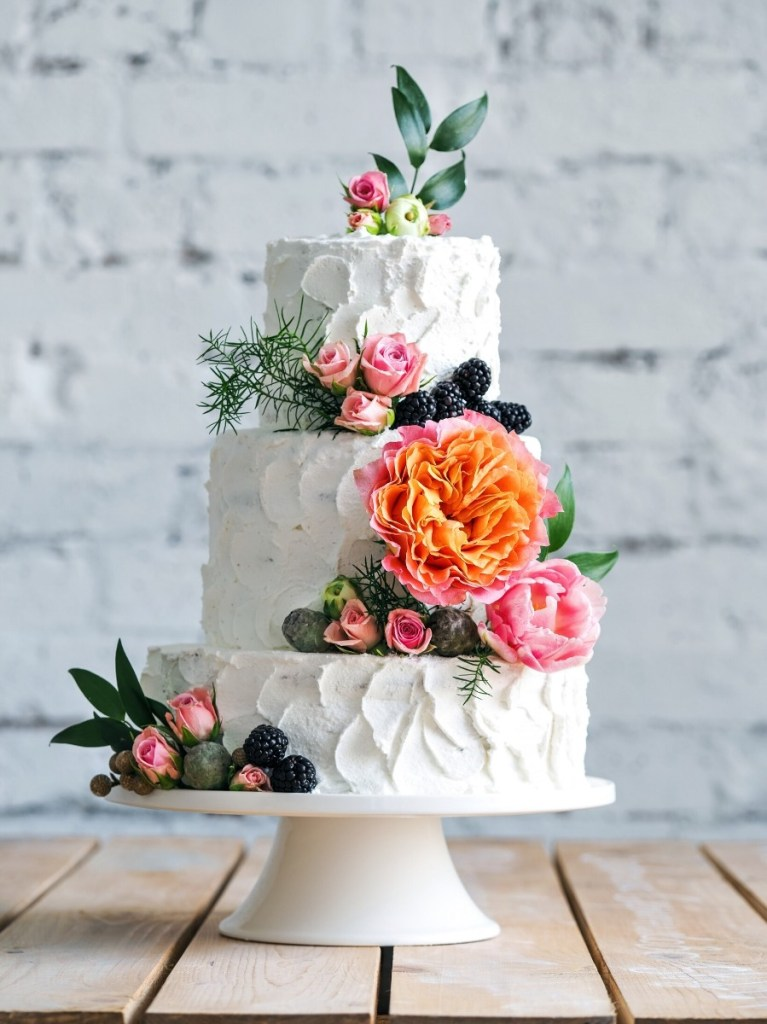Flowers and Stucco Wedding Cake