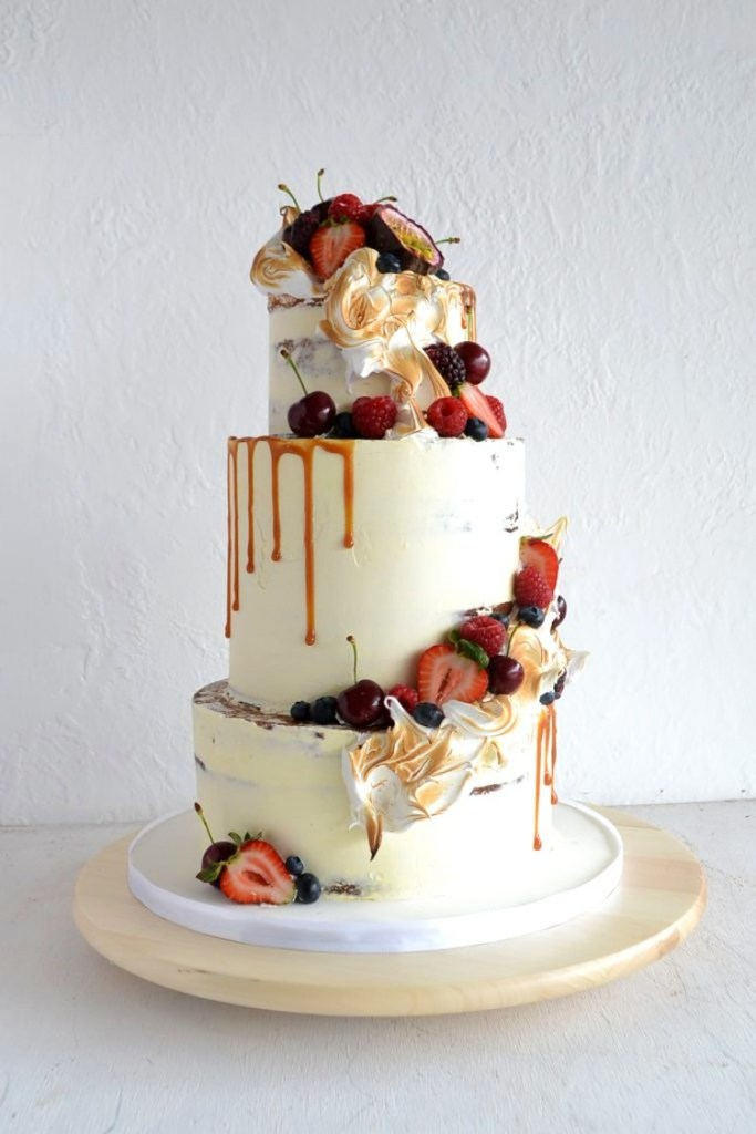 Cascading Fruit, Marshmallow, and Dripping Caramel Wedding Cake by Miss Ladybird Cakes