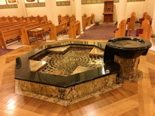 The baptismal font is the only part of the church that does not seem to fit with the rest. It does not match my personal preference, but it is well-made.