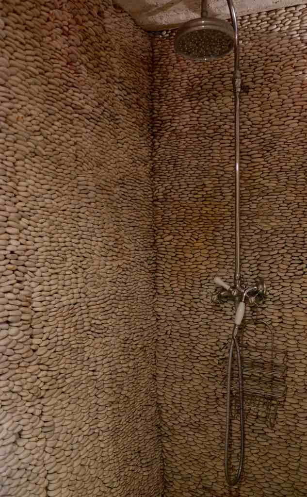 Shower wall, all made from river stones