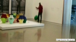 As we mentioned, this past Saturday Maximo Caminero destroyed one of Ai Wei Wei's 16 Colored Vases valued at $1 million.