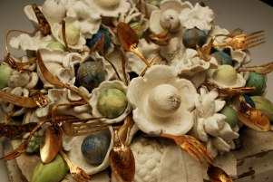 "porcelain and handmade glaze cone 6, Katrina rusted flatware, antique column base, 28"" x 28"" x 12"", 2007"