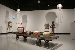 70 x 20 x 13 inches, Fired Clay and Glaze, Wood, Balloon, Tape, Skittles