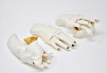 This sculpture combines use of a 4-part mold of the artist's hand with a found 3-part bird mold. The pieces are altered and combined then wrapped with slip-dipped paper towels.
