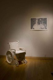 "Installation at Fleisher, press molded porcelain wheel chair, three color print, 25"" x 32"", 2009"