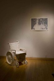 """Installation at Fleisher, press molded porcelain wheel chair, three color print, 25"""" x 32"""", 2009"""