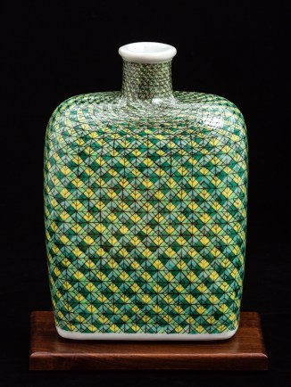 The Woven Bourbon Bottle was press-molded and gas reduction fired. Hand-painted gucai over-glaze enamels were electric fired. Enamels were built up abstractly to highlight the inherent luminosity and tactile qualities of the transparent over-glaze media.