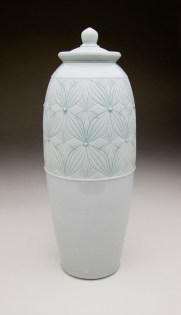 Porcelain with carved pattern, 21H x 6.5W x 6.5D""