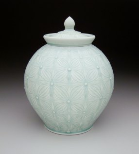 Porcelain with carved pattern, 14H x 9W x 9D""
