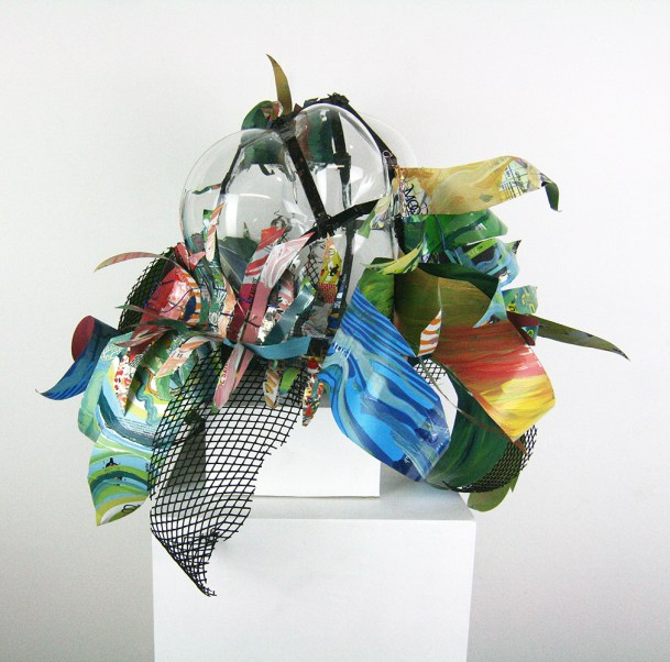 Hand blown glass with repurposed aluminum and plastic that has been hand painted.