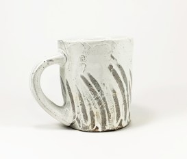 Local NC Stoneware with white slip, clear glaze, and finger marks. Wood Fired for 3 days.