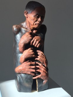 Holding describes the beauty and grace of aging. The figure has no arms or hands of its own as there is a helplessness and inability to stop the aging process. The multiple hands show a holding on of a life force or essence while the crack is a symbol of the loss of physicality. There is gold leaf at the entrance to the crack supporting the idea that the soul is the jewel. Beautiful is one who has lived through the tibulations of time but continues to sparkle with the hope and shine of life.