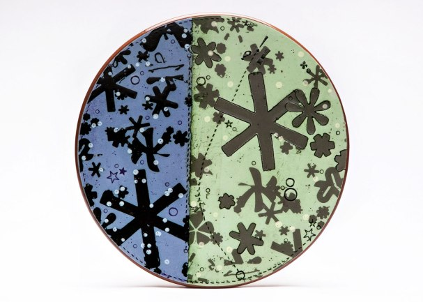 Asterisk Dinner Plate, 2014. Ceramic, slip, underglaze, glaze and luster. Screen printed underglaze transfers, paper resists, and multi-fired in an electric kiln. 1 x 9 x 9 inches