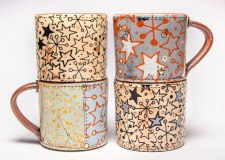 Retro Star Cups, 2014. Ceramic, slip, underglaze, glaze and luster. Screen printed underglaze transfers and multi-fired in an electric kiln. 4.25 x 3.75 x 3.75 inches each
