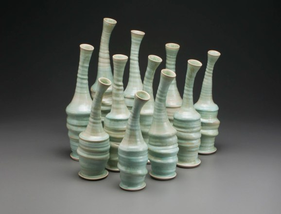 "2015, vary 15"" x 6"" x 5"" (h x w x d), Porcelain clay, Green Glaze, Wheel thrown, altered and assembled clay that has been glazed and fired in oxidation to cone 6 in an electric kiln."