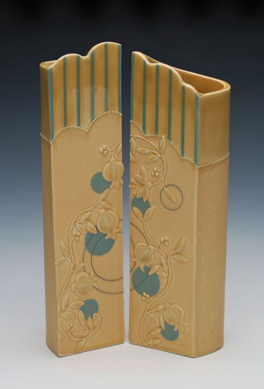 "Hand-built porcelain w. slip-sponge, slip-trail, underglaze, and Mishima deco, cone 7 oxidation. Each approx. 13"" h x 3.5"" w x 3""d, 2014"