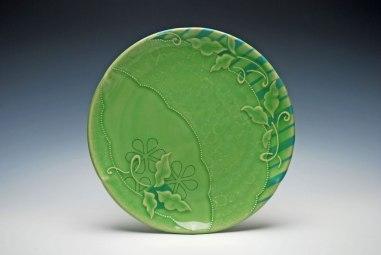 "Wheel-thrown and altered porcelain w. slip-sponge, underglaze, slip-trail, and Mishima deco, cone 7 oxidation. 11"" diameter x 2"" h, 2014"
