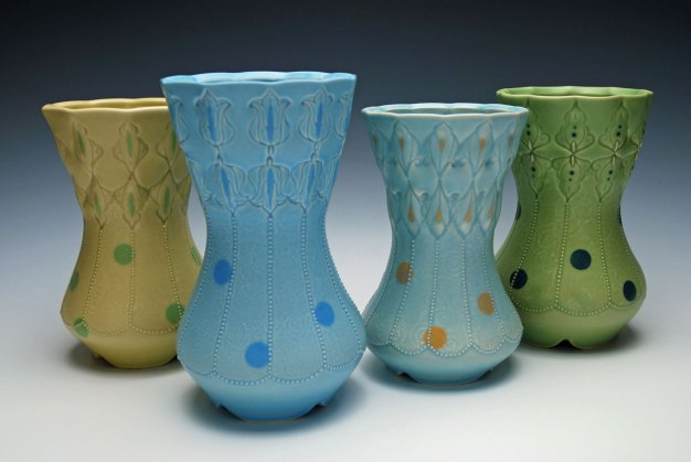 """Wheel-thrown, stamped, and altered porcelain w. slip-sponge, underglaze, and slip-trail deco, cone 7 oxidation. Each approx. 8"""" h x 5"""" diameter, 2014"""