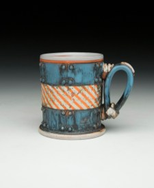 "4""H x 4""x 3.5""L. Earthenware, wheelthrown. Terra sigillita, underglaze. Electric fired cone 04"