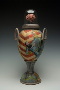 "24""H x 9.5""x 9.5""L. Earthenware, wheelthrown. Terra sigillita, underglaze. Platiunum Luster. Commercial glass dome. Electric fired cone 04"