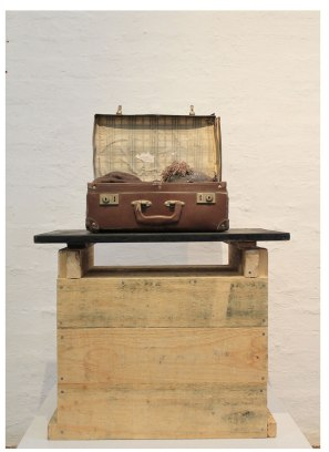Ceramic, found suitcase, blanket, thread and wood, 63cm x 40cm x 90cm, 2014