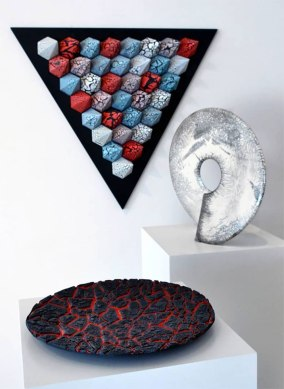 "exhibition image of 3 works, wall sculpture, White raku ""Coriolis"" form and ""Lava"" earthenware platter"