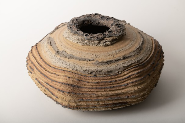 The volcanic glaze is brushed on the top and on the texture edge. Yellow clay fired to cone 6