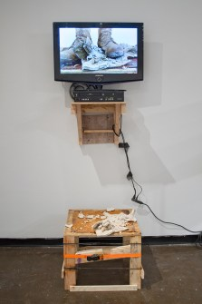 """TV, wood, steel, porcelain, ratchet strap, video (loop), US Army desert combat boot, extension cable, RCA cables, 100mph tape, 80x32x28"""", 2016"""