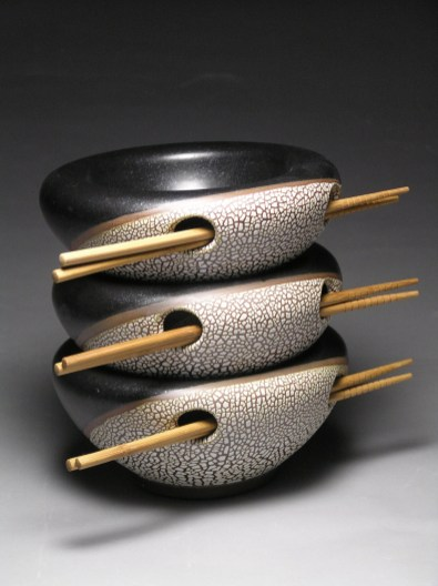 Double walled bowls, altered with black satin and reticulating glazes. Cone 10.