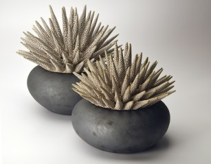 Thrown/inflated with hand-built lids. Barnard slip and reticulating glazes. Cone 10.