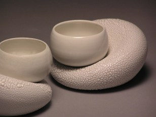 Thrown/inflated porcelain with white satin and reticulating glazes. Cone 10