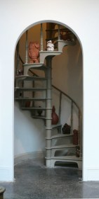 Site Specific Installation in 20' spiral staircase at Woodmere Art Museum, 2013, Terracotta