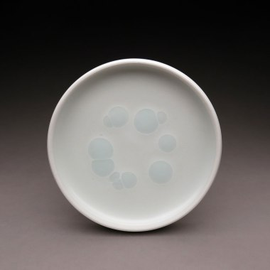"""Plate. Porcelain with accent glaze. 7"""" in diameter"""