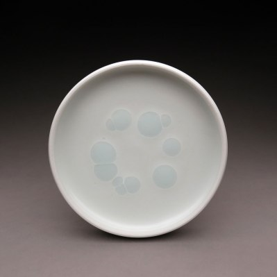 "Plate. Porcelain with accent glaze. 7"" in diameter"