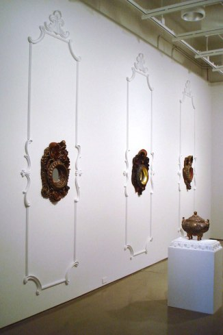{Frame}. Installation View, 13'h x 19'w. Ceramic, glaze, plaster, paint, gold leaf, velvet. 2010.