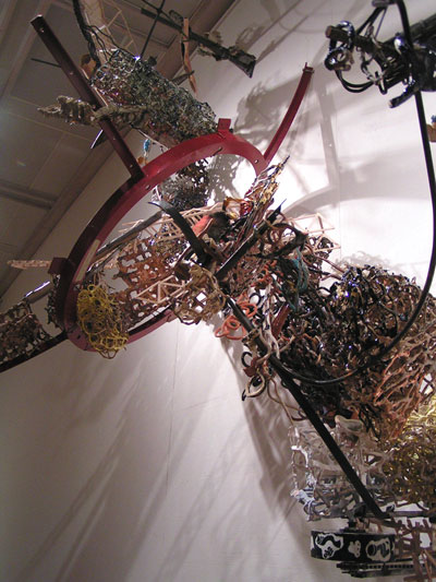 View from underneath:hand-pinched ceramics colonizing student and staff sculpture borrowed from WSU metal shop