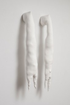 """60"""" x 32"""" x 10"""", unfired porcelain, fabric, stuffing, thread, glue, fired clay"""